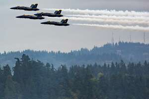 The U.S. Navy Blue Angels perform over Lake Washington during Seafair on Saturday, Aug. 6, 2016.