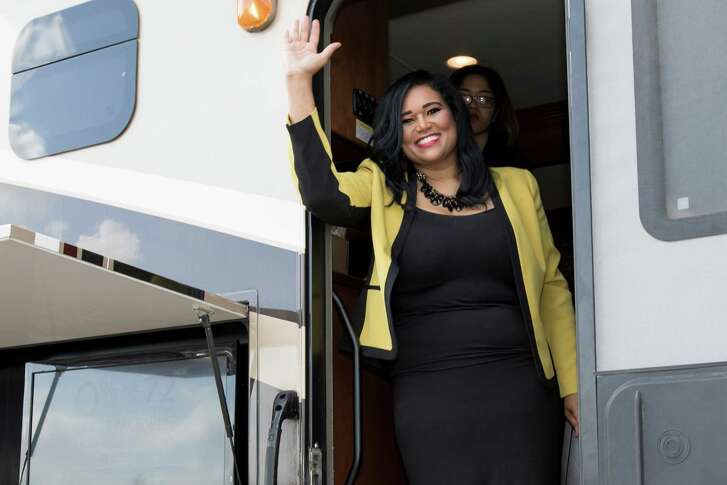 Shawn Thierry waves from her bus at  the election to fill Texas House District 146 at  the Sunnyside Multi-Service Center in Houston, TX, on Saturday, August 6, 2016.