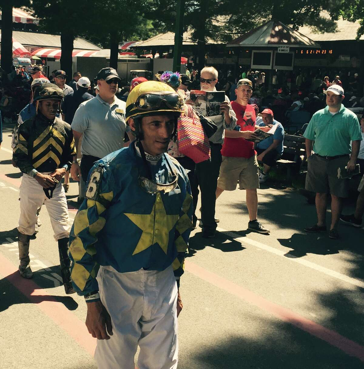 After each and every race at Saratoga, there is only one way for the jockeys to get back to their dressing room from the track. And that is to walk through the crowd. Here, John Velazquez, foreground, makes his way back after finishing second in the fourth race. That's Luis Saez, who rode Rise 'n' Tuck (finished sixth), in the background. Can you imagine athletes from other sports wading through the crowd after a game? Am sure David Ortiz would have a blast walking amongst the fans at Yankee Stadium or Jacoby Ellsbury chatting up the crowd at Fenway. ?-Tim Wilkin