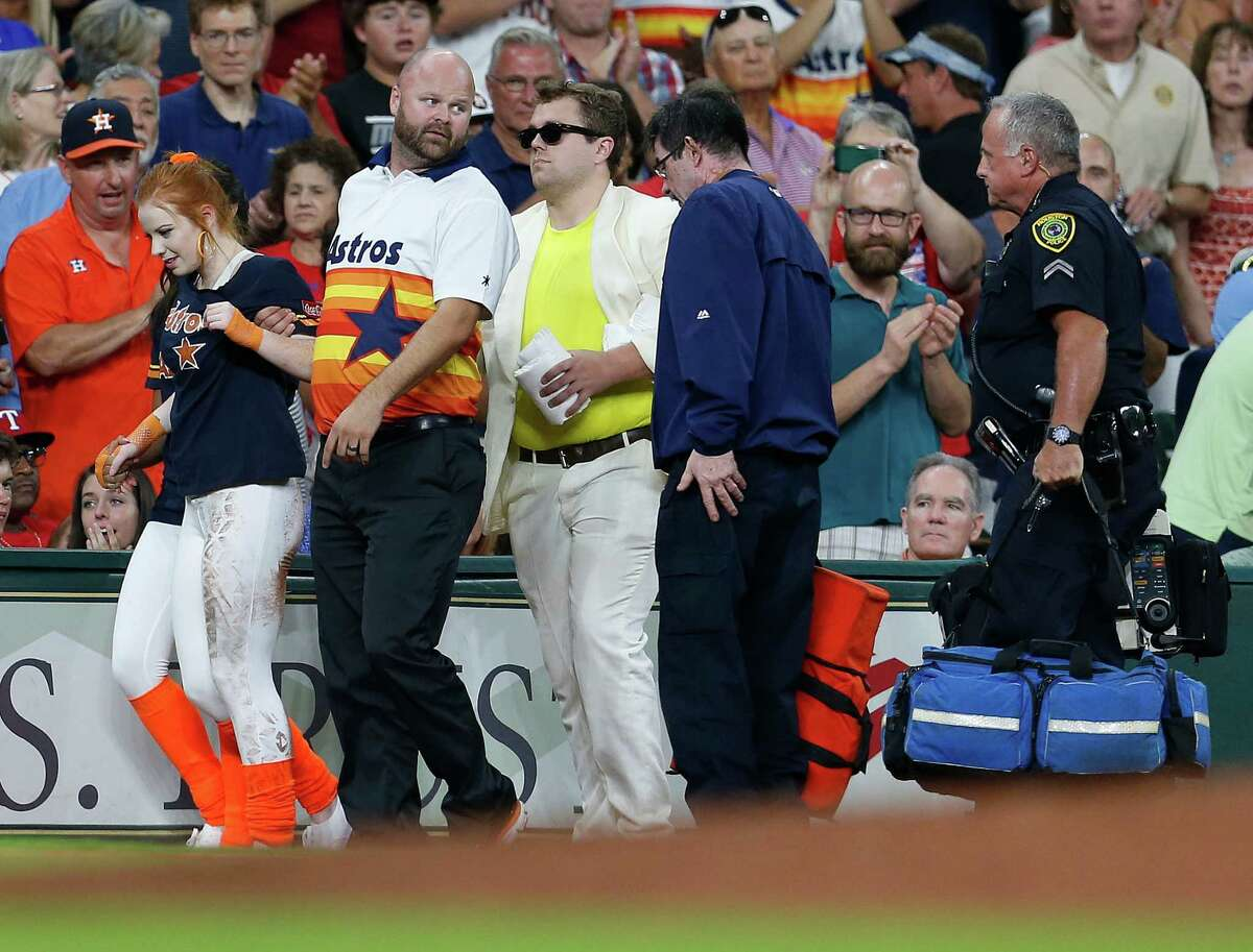A member of the Shooting Stars is aided after being run over by the buggy carrying Orbit during the sixth inning of an MLB game at Minute Maid Park, Saturday, Aug. 6, 2016, in Houston. Browse through the photos to see some of the strangest things that have happened at Minute Maid Park.