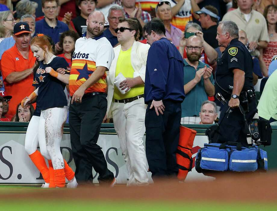 A member of the Shooting Stars is aided after being run over by the buggy carrying Orbit during the sixth inning of an MLB game at Minute Maid Park, Saturday, Aug. 6, 2016, in Houston.It was a strange accident. Keep clicking for a look at other strange things that have happened at Minute Maid.  Photo: Karen Warren, Houston Chronicle / © 2016 Houston Chronicle