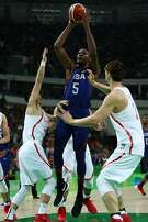 RIO DE JANEIRO, BRAZIL - AUGUST 06: Kevin Durant #5 of United States shoots over Zhelin Wang #31 of China in the Men's Preliminary Round Group A match on Day 1 of the Rio 2016 Olympic Games at Carioca Arena 1 on August 6, 2016 in Rio de Janeiro, Brazil.  (Photo by Elsa/Getty Images)
