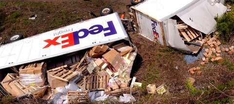 FedEx truck tumbles off I-84 in Danbury - NewsTimes
