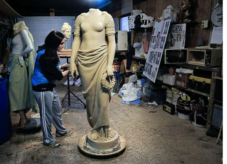 """Sculptor Emily Bedard, of Milton, VT, working in her studio on a replica of a white marble statue, """"Liberty,"""" which was part of the Soldiers and Sailors Monument in Seaside Park until it was vandalized and lost roughly 40 years ago. Photo: Contributed Photo / Connecticut Post Contributed"""