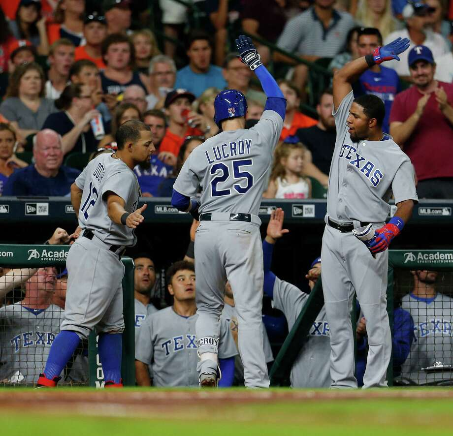 Texas Rangers catcher Jonathan Lucroy (25) celebrates his home run with teammates during the sixth inning of an MLB game at Minute Maid Park, Saturday, Aug. 6, 2016, in Houston. Photo: Karen Warren, Houston Chronicle / © 2016 Houston Chronicle