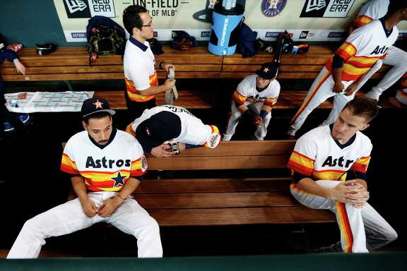 Houston Astros in the dugout with their Rainbow uniforms before the start of the first inning of an MLB game at Minute Maid Park, Saturday, Aug. 6, 2016, in Houston.