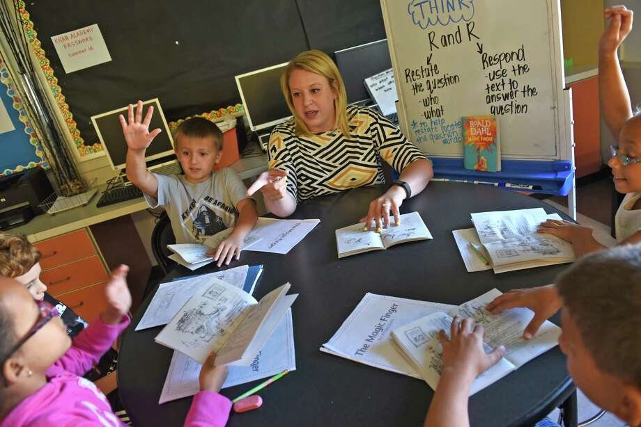 Genet Elementary fourth grade teacher Jessica Csakany works with third grade students in a special education summer school class at Goff Middle School on Friday Aug. 5, 2016 in East Greenbush, N.Y. (Michael P. Farrell/Times Union) Photo: Michael P. Farrell / 20037565A