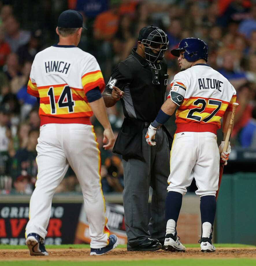 Jose Altuve, right, has a few choice words for plate umpire Alan Porter after being called out on strikes in the seventh inning, earning his first ejection. Photo: Karen Warren, Staff / © 2016 Houston Chronicle