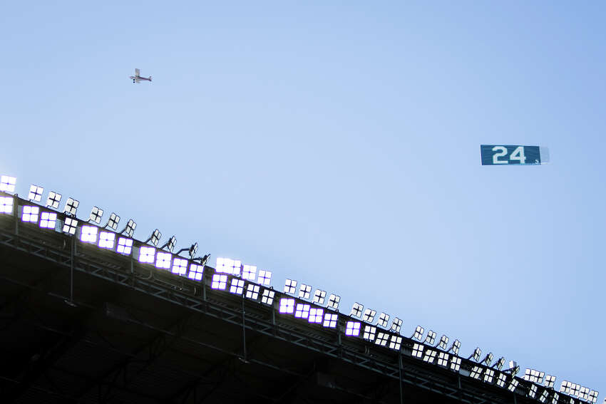 A plane flies Ken Griffey Jr.'s jersey number over Safeco Field before the number retirement ceremony on Saturday, Aug. 6, 2016.(Lacey Young, seattlepi.com)