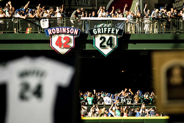 Ken Griffey Jr.'s daughter Taryn Griffey unveils his retired number 24 alongside Jackie Robinson's in center field of Safeco Field on Saturday, August 6, 2016. (Lacey Young, seattlepi.com)