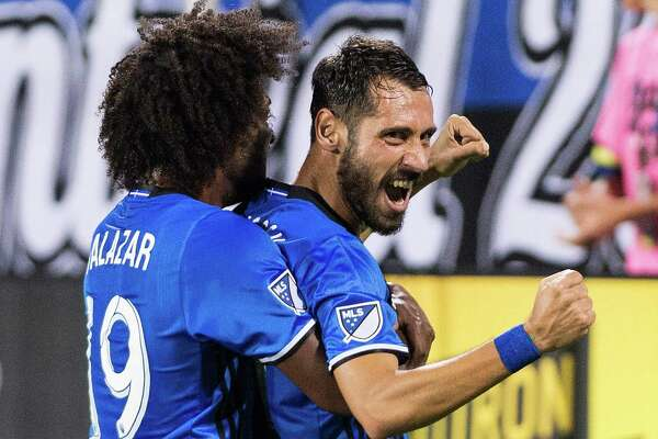Montreal Impact's Matteo Mancosu, right, celebrates with teammate Michael Salazar after scoring against the Houston Dynamo during second-half MLS soccer game action in Montreal, Saturday, Aug. 6, 2016. (Graham Hughes/The Canadian Press via AP)