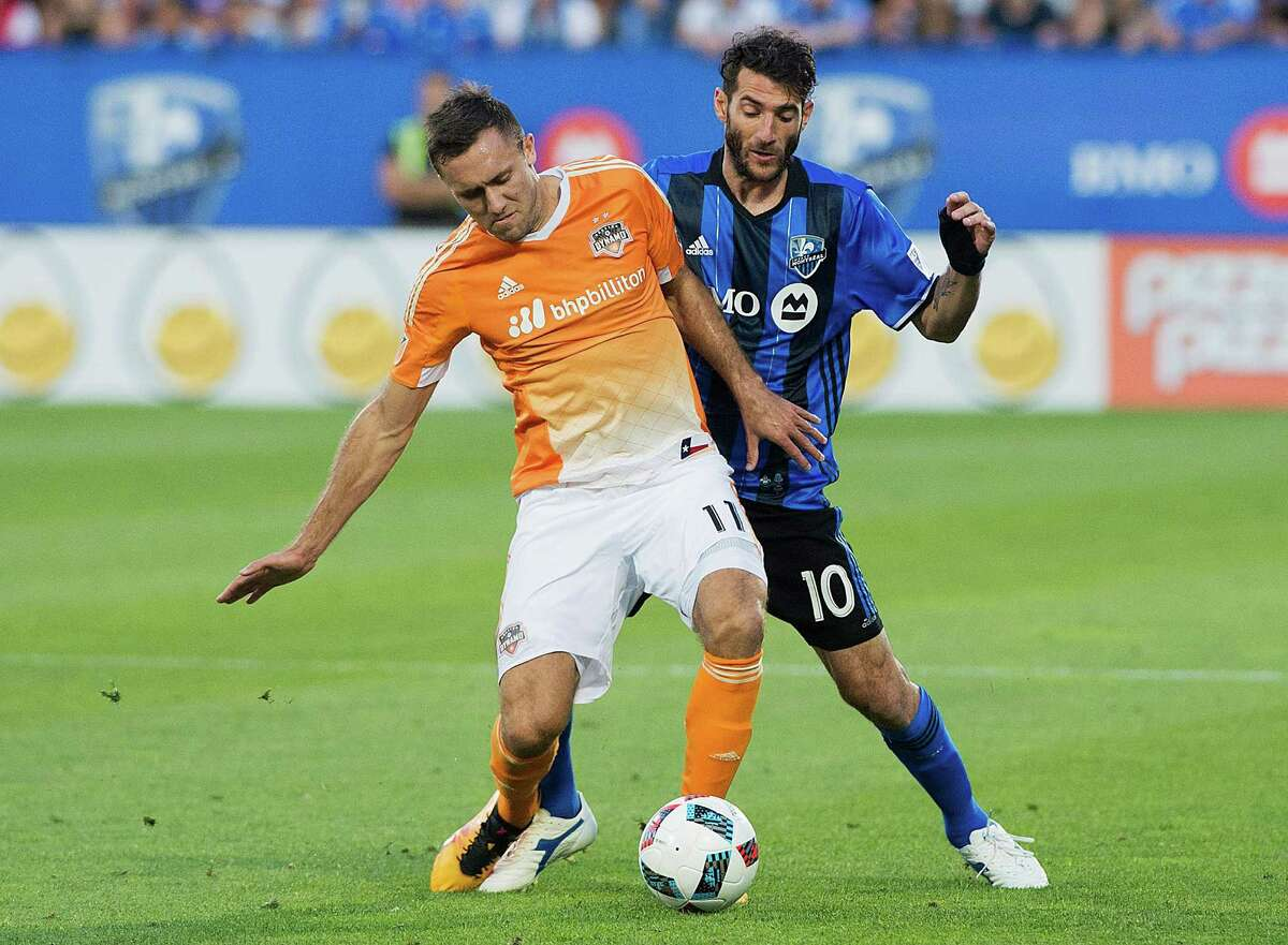 Montreal Impact's Ignacio Piatti (10) is challenged by Houston Dynamo's Andrew Wenger during first-half MLS soccer game action in Montreal, Saturday, Aug. 6, 2016. (Graham Hughes/The Canadian Press via AP)