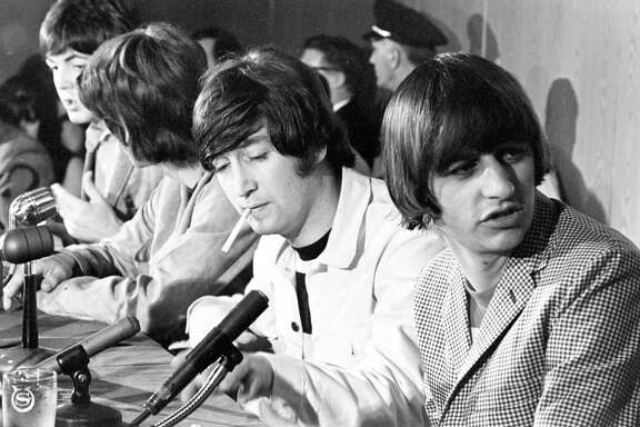 The Beatles - Paul McCartney, George Harrison, John Lennon and Ringo (Starr) Starkey - at press conference at the Sheraton Lincoln before their performance at the Coliseum, August 19, 1965. Â Houston Chronicle