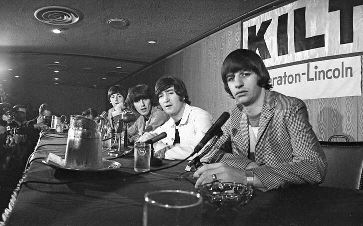"At a Beatles news conference the day of their shows, John Lennon, second from right, noted, ""We haven't seen much of Texas."""