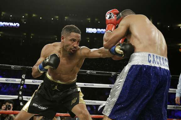 Andre Ward, left, punches Alexander Brand, of Colombia, right, during the 12th round of their light heavyweight boxing match Saturday, Aug. 6, 2016, in Oakland, Calif. Ward won the fight in a unanimous decision. (AP Photo/Eric Risberg)