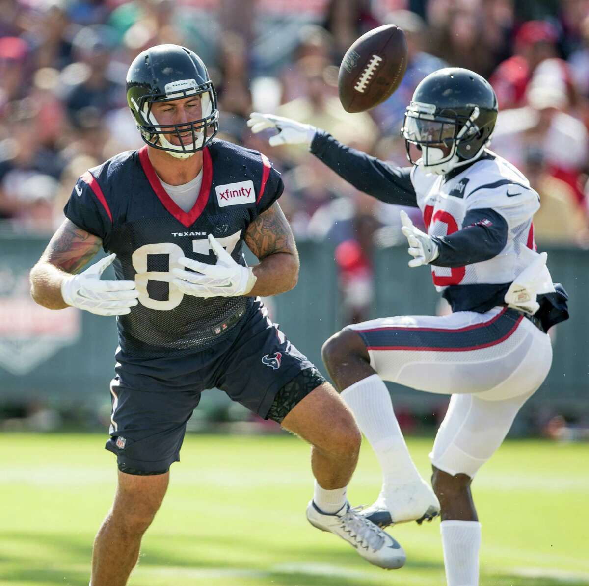 Houston Texans defensive back Corey Moore (43) breaks up a pass intended for tight end C.J. Fiedorowicz (87) during Texans training camp at Houston Methodist Training Center on Sunday, Aug. 7, 2016, in Houston.
