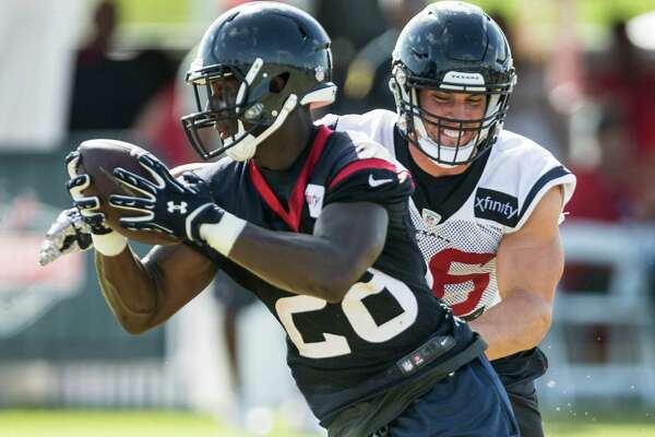 Houston Texans inside linebacker Brian Cushing (56) runs in to defend a reception by running back Alfred Blue (28) during Texans training camp at Houston Methodist Training Center on Sunday, Aug. 7, 2016, in Houston.