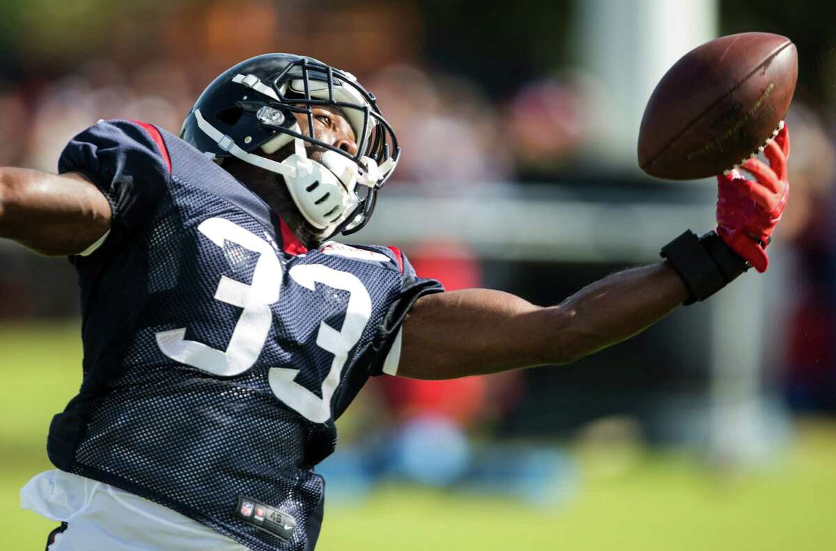 Houston Texans running back Akeem Hunt reaches up to catch a football during Texans training camp at Houston Methodist Training Center on Sunday, Aug. 7, 2016, in Houston.