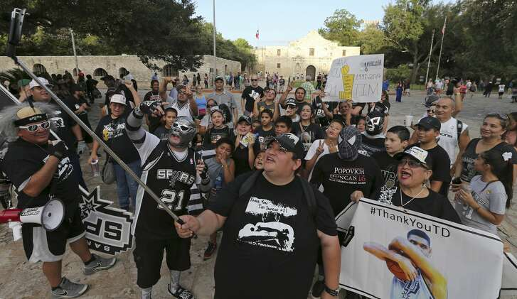 Spurs and Tim Duncan fans take a group selfie after marching from the Tower of the Americas to the Alamo Saturday Aug. 6, 2016.