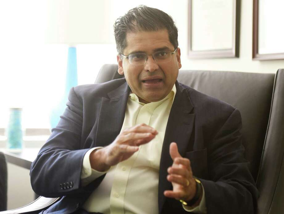 Psychiatrist Tarique Perera, M.D., speaks in the office of his practice, Contemporary Care, in Greenwich, Conn. Thursday, Aug. 4, 2016. Contemporary Care has a machine used to perform transcranial magnetic stimulation (TMS), a magnetic method used to stimulate small regions of the brain that can be used to treat depression, anxiety, post-traumatic stress disorder, eating disorders and other mental illnesses. Photo: Tyler Sizemore / Hearst Connecticut Media / Greenwich Time
