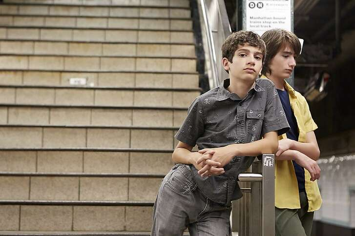 """This image released by Magnolia Pictures shows Michael Barbieri, left, and Theo Taplitz in a scene from, """"Little Men."""" (Magnolia Pictures via AP)"""