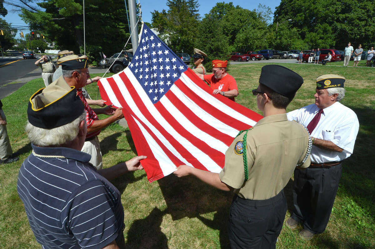 At American Legion Post 12 in Norwalk, the Color Guard raises the flag for the month of August for Veteran of the Month Edwin Lorenzo Tuttle. Tuttle fought in the Civil War and is the first from that war to be honored by the post.