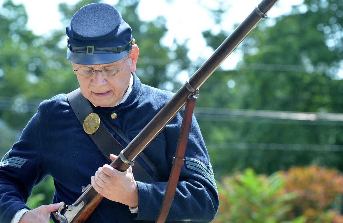 Tom Bierly dressed as a Civil War Infantryman reloads his 1863 Springfield Rifle Musket for another volly during the Veteran of the Month ceremony honoring Civil War vet Edwin Lorenzo Tuttle, at American Legion Post 12 in Norwalk on Sunday.