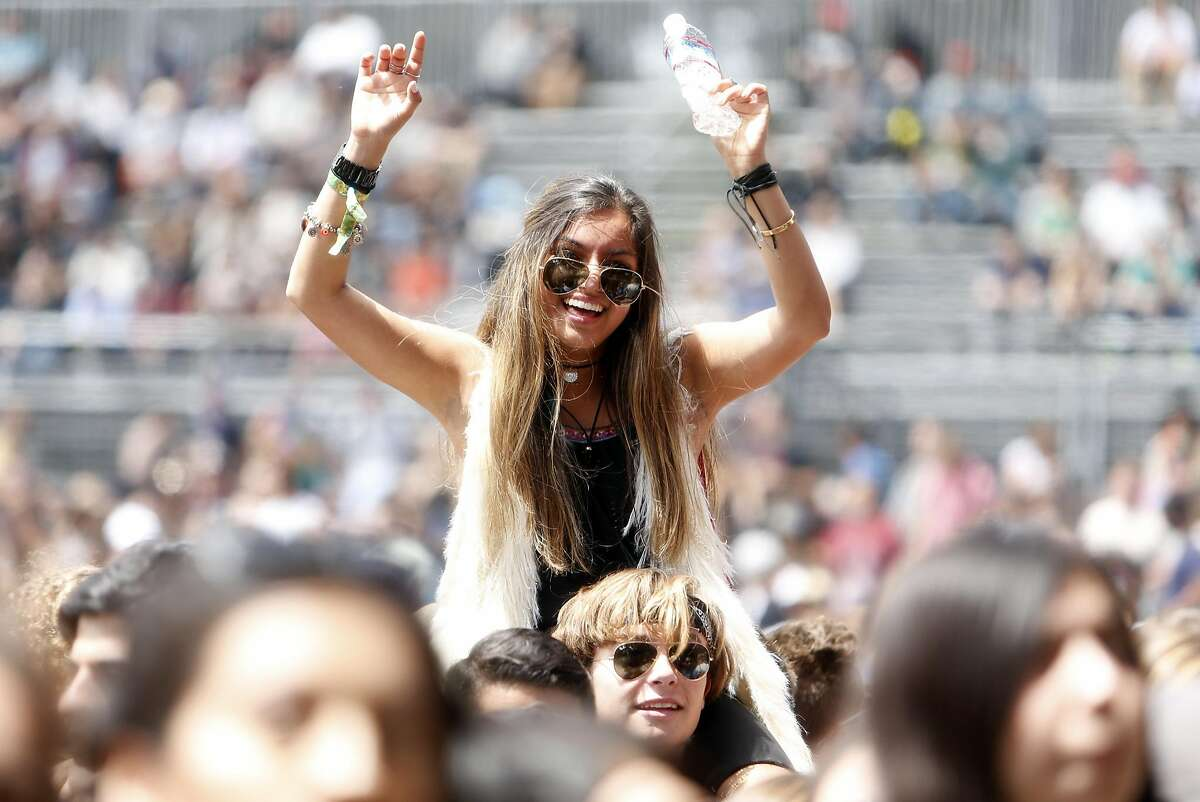 Two young festival goers enjoy Snakehips during Day 3 of Outside Lands in Golden Gate Park in San Francisco, Calif., on Sunday, August 7, 2016.