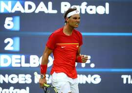 RIO DE JANEIRO, BRAZIL - AUGUST 07:  Rafael Nadal of Spain reacts after winning a point against Federico Delbonis of Argentina in their first round match on Day 2 of the Rio 2016 Olympic Games at the Olympic Tennis Centre on August 7, 2016 in Rio de Janeiro, Brazil.  (Photo by Clive Brunskill/Getty Images)