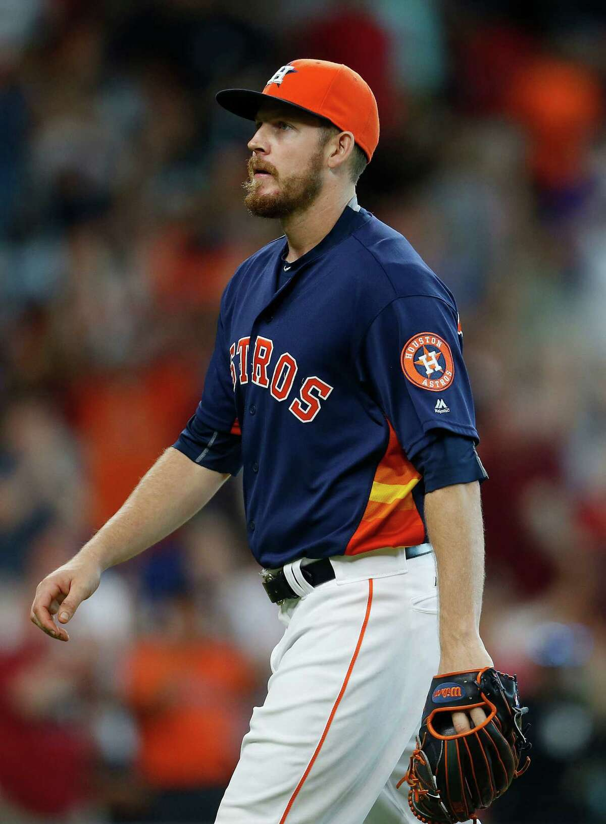 Houston Astros relief pitcher Chris Devenski (47) walks back to the dugout after the tenth inning of an MLB game at Minute Maid Park, Sunday, Aug. 7, 2016, in Houston.