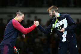 RIO DE JANEIRO, BRAZIL - AUGUST 07:  Gold medalist Daniele Garozzo (R) of Italy shakes hands with silver medalist Alexander Massialas of the United States during the medal ceremony for the Men's Individual Foil Final on Day 2 of the Rio 2016 Olympic Games at Carioca Arena 3 on August 7, 2016 in Rio de Janeiro, Brazil.  (Photo by Alex Livesey/Getty Images)