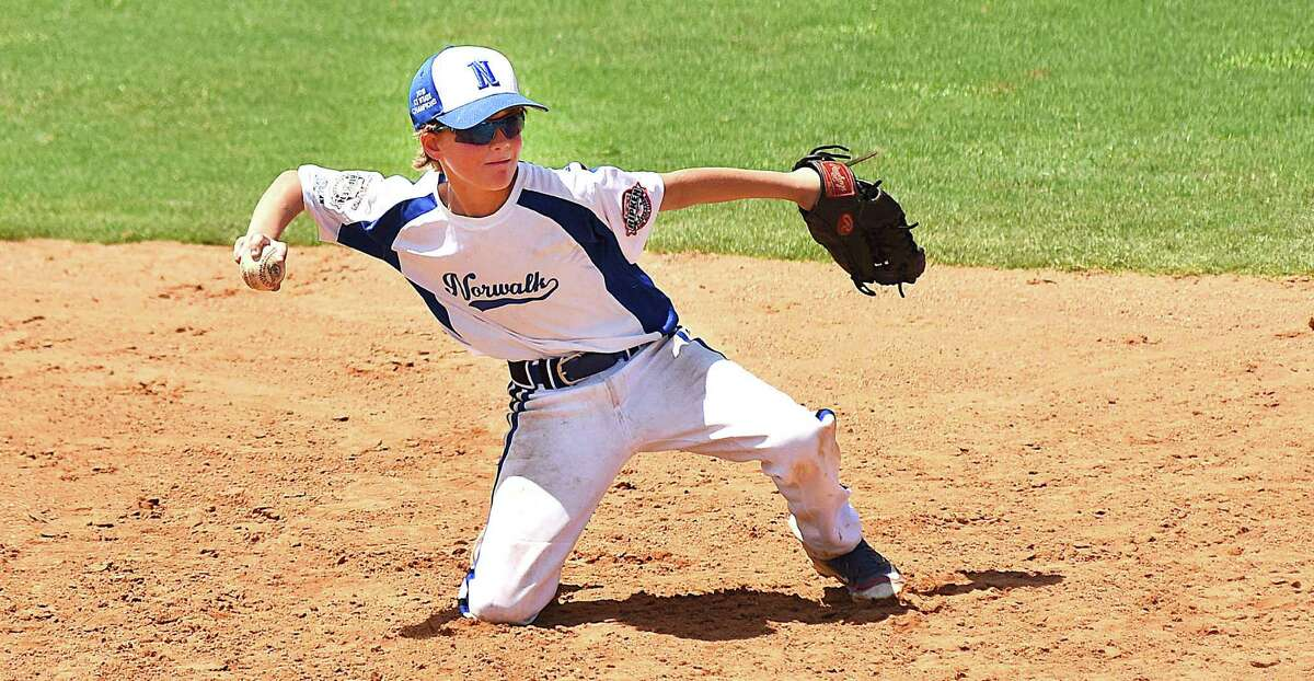 Norwalk shortstop Henry Feinstein goes to a knee to pivot and force a runner at second base during Sunday's Cal Ripken 10-year-old All-Star World Series game against the Mineral Area, Mo., Falcons at Gardens Park in Palm Springs Gardens, Fla.