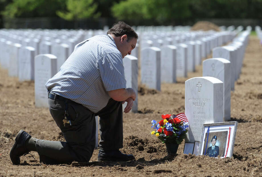 Patrick Miller visits the grave of his son, Army Private 1st Class Anthony Scott Miller, on the sixth anniversary of his death in Iraq on Tuesday, April 7, 2009. Anthony Miller was the first San Antonio to die in Operation Iraqi Freedom. BILLY CALZADA / gcalzada@express-news.net Photo: BILLY CALZADA, STAFF / SAN ANTONIO EXPRESS-NEWS / gcalzada@express-news.net