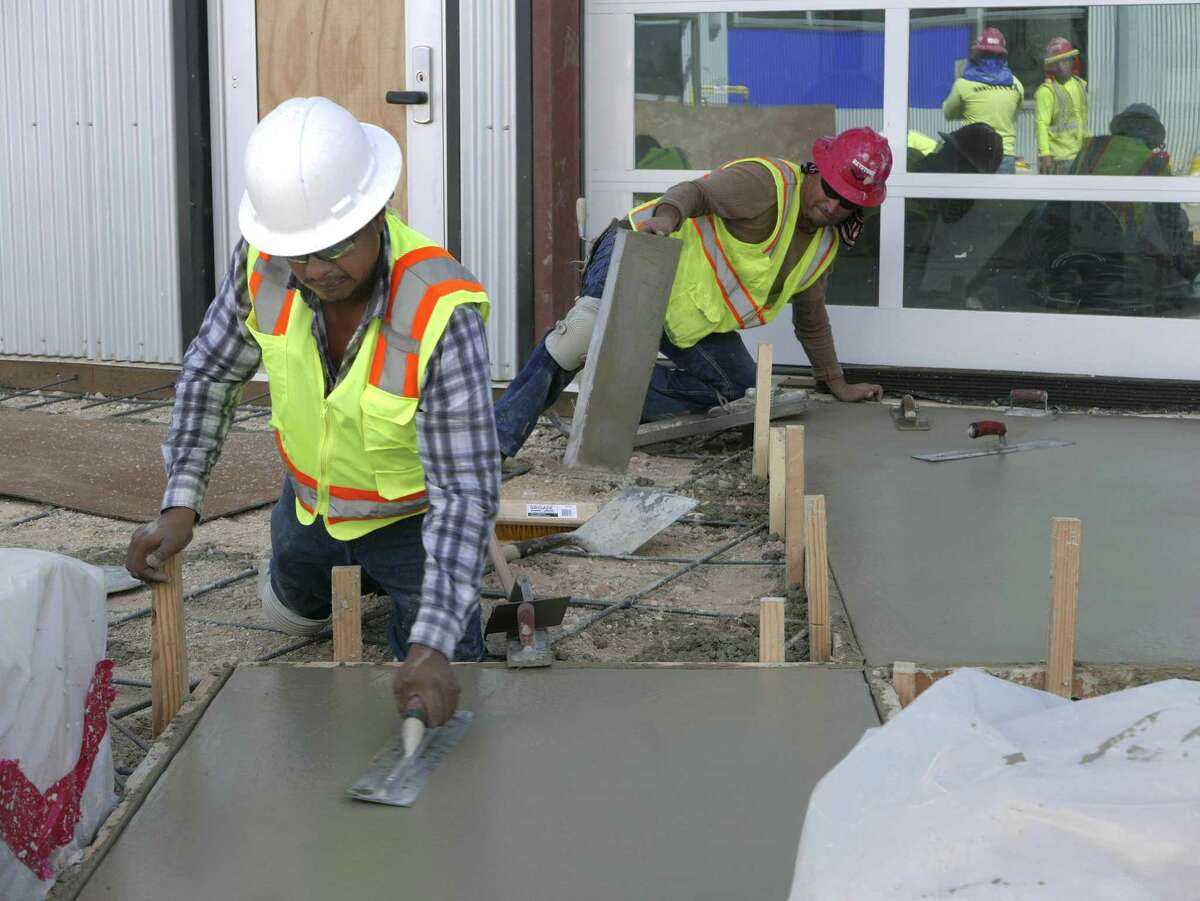 Construction workers lay cement at the KIPP Cevallos campus before it opened in 2016, part of a wave of charter school expansion in San Antonio that could continue in August from five new charter networks whose applications are now being reviewed by the state.