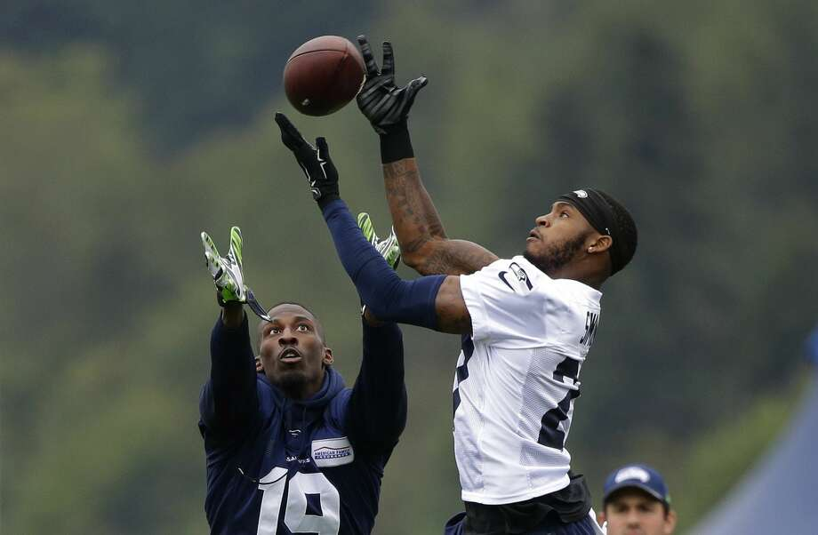 Seattle Seahawks cornerback Tharold Simon, right, deflects a pass intended for wide receiver Douglas McNeil, left, during NFL football training camp, Saturday, Aug. 6, 2016, in Renton, Wash. (AP Photo/Ted S. Warren) Photo: Ted S. Warren/AP
