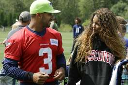 Seattle Seahawks quarterback Russell Wilson, left, walks with his wife, pop singer Ciara, following NFL football training camp, Saturday, Aug. 6, 2016, in Renton, Wash. (AP Photo/Ted S. Warren)