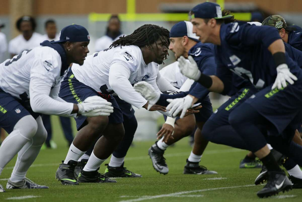 Seattle Seahawks defensive tackle Brandin Bryant, second from left, gets ready to block from the line of scrimmage during NFL football training camp, Saturday, Aug. 6, 2016, in Renton, Wash. (AP Photo/Ted S. Warren)