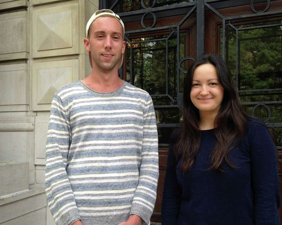 In this Aug. 2, 2016 photo, Ian Bradley-Perrin, left, and fellow graduate student Olga Brudastova, pose for a photo on the campus of Columbia University in New York. Both are active in the campaign to unionize grad students who work as teaching and research assistants at Columbia. (AP Photo/Karen Matthews) ORG XMIT: NYR301 Photo: Karen Matthews / Copyright 2016 The Associated Press. All rights reserved. This m