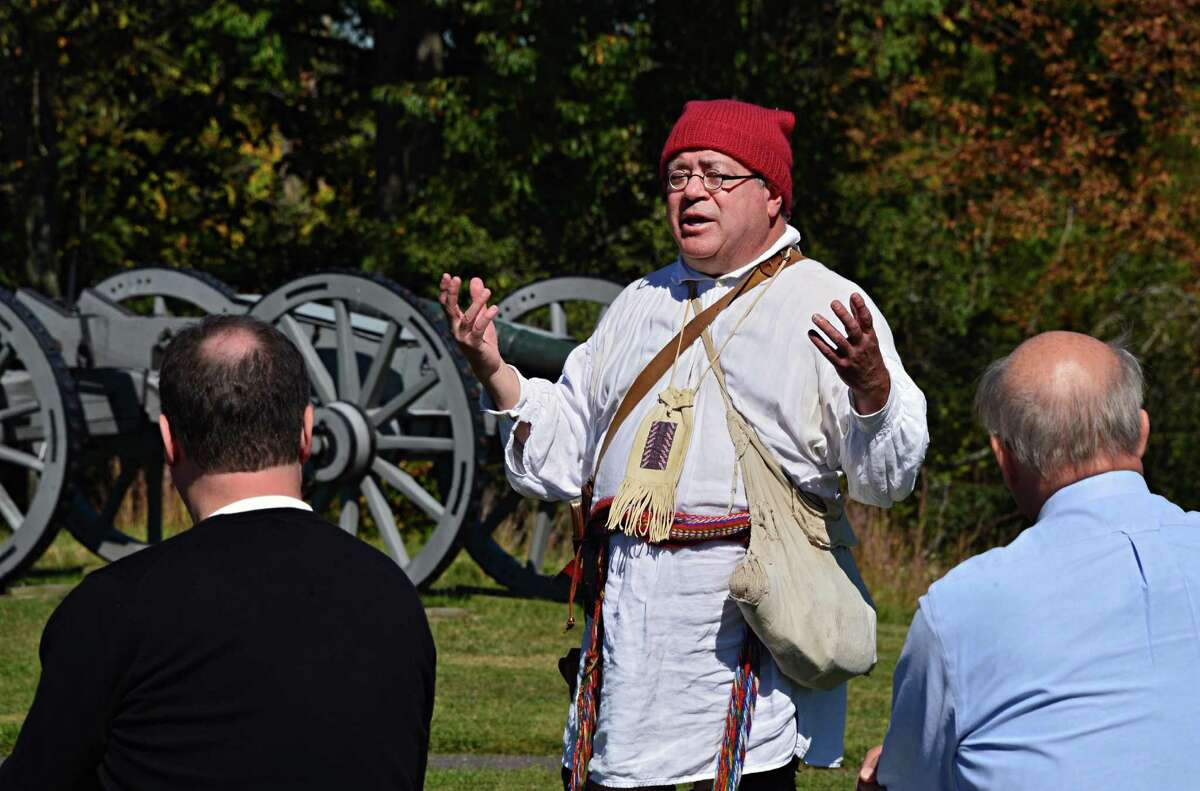 Official battlefield guide Jim Hughto, center, of Waterford, lectures a tour group at Saratoga National Historical Park Wednesday Sept. 18, 2013, in Stillwater, NY. (John Carl D'Annibale / Times Union)