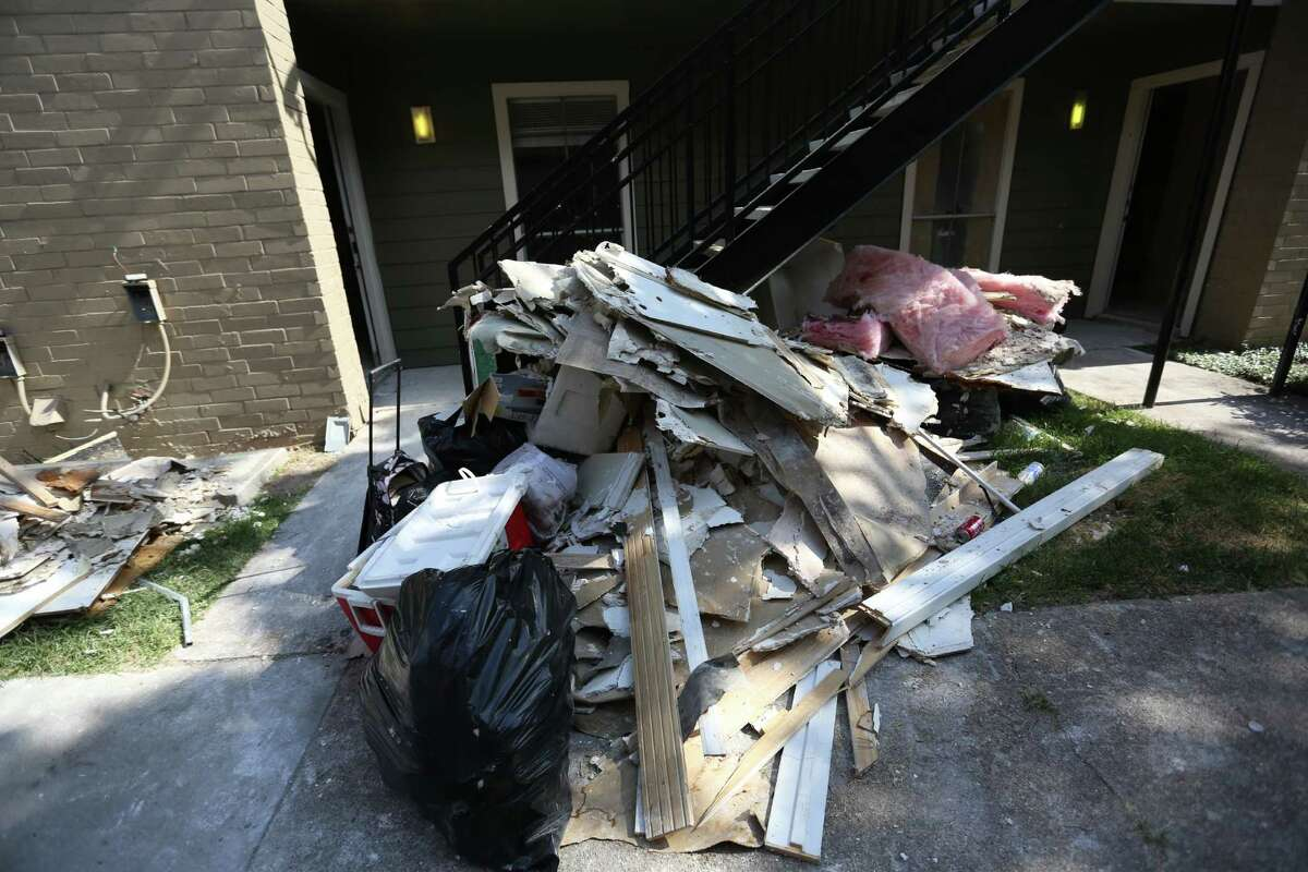 Apartment residents say that the debris stays out for weeks after it is torn out of damaged apartments. Families talk about how life has been since the tax-day floods that displaced many Greenspoint residents on Monday, July 25, 2016, in Houston.