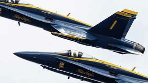 The U.S. Navy Blue Angels fly in close formation during their final performance during Seafair Weekend, Sunday, Aug. 7, 2016.