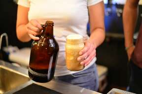 """Eager patrons enjoyed frosty beer floats at a """"pop up dessert brunch"""" at The Granary 'Cue & Brew Sunday, Aug. 7, 2016."""