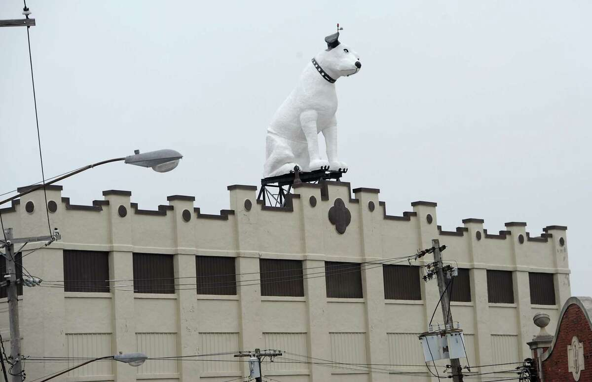 Arnoff Moving and Storage on Broadway is up for sale on Monday, Dec. 8, 2014 in Albany, N.Y. The building is known for its 28 ft fiberglass RCA dog known as Nipper.(Lori Van Buren / Times Union)