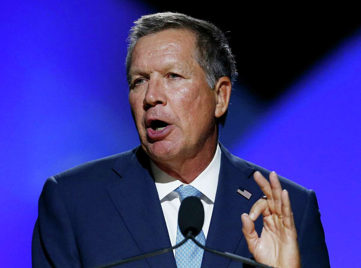 FILE - In a Sunday, July 17, 2016 file photo, Ohio Gov. John Kasich addresses the 2016 National Convention of the NAACP, in Cincinnati. Kasich says he has no idea how he'll vote come November because he doesn't support Donald Trump or Hillary Clinton. He also says he isn't sure whether Trump can win Ohio if he remains so divisive. (AP Photo/Gary Landers, File) ORG XMIT: NY110