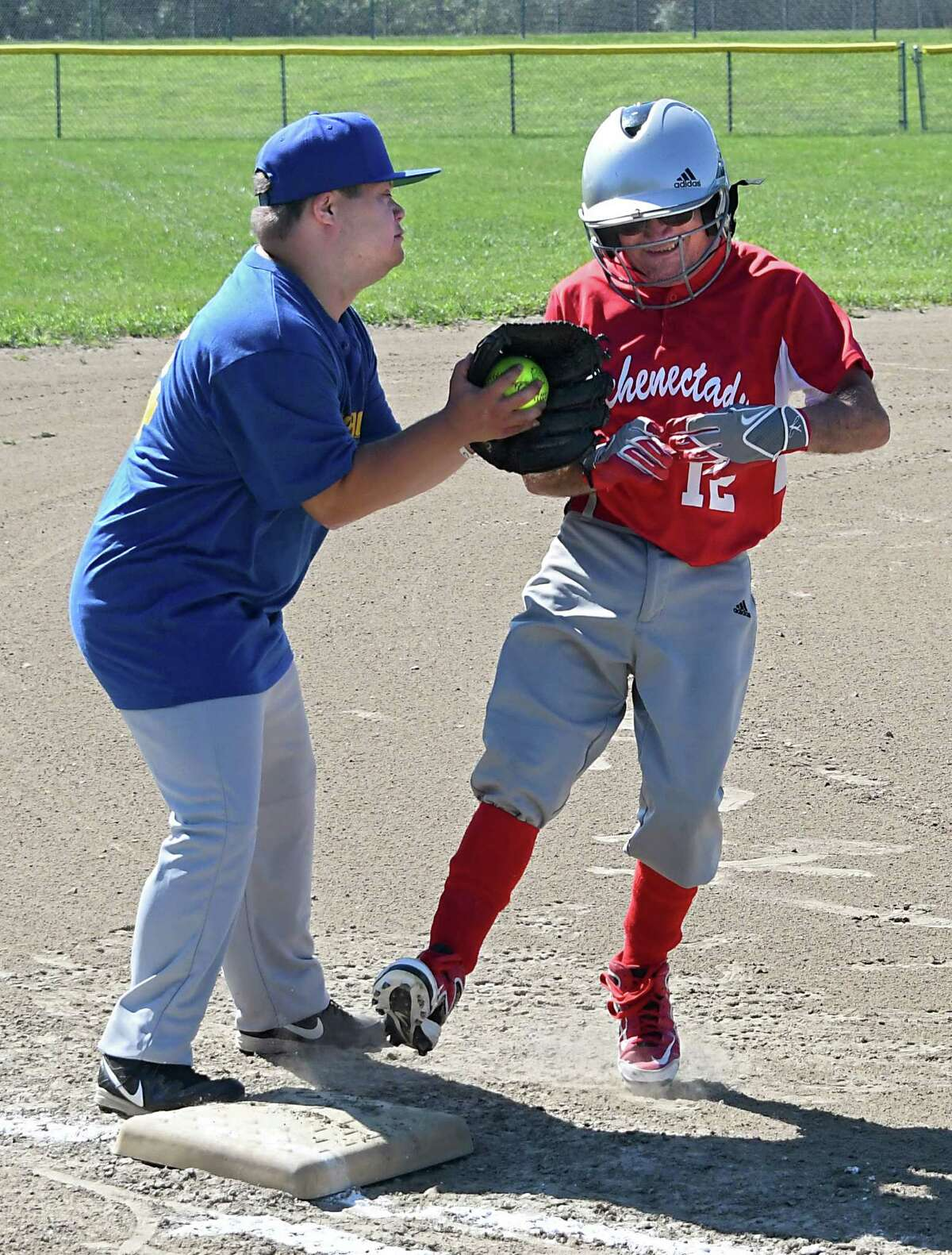 Third baseman Phil Isaacson of the Thunderbolts tags out Roger Foster of the Schenectady South Paws during the Special Olympics New York's 2016 Capital District Local Softball Tournament held at Veterans Memorial Park at Elks Trail on Sunday, Aug. 7, 2016 in Clifton Park, N.Y. (Lori Van Buren / Times Union)