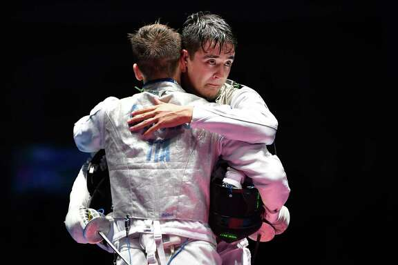 Alexander Massialas, right, of the U.S. couldn't overcome Italy's Daniele Garozzo in the foil final, but the first silver medal for an American in the event since 1932 was a nice consolation prize.