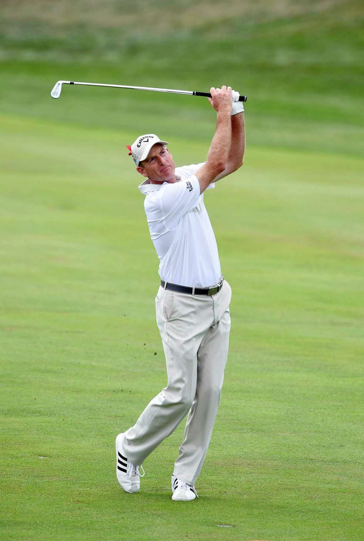 Jim Furyk watches his approach shot on the 18th hole on his way to shooting a PGA record 58 during the final round of the Travelers Championship golf tournament in Cromwell, Conn., Sunday, Aug. 7, 2016. (AP Photo/Fred Beckham) ORG XMIT: CTFB106
