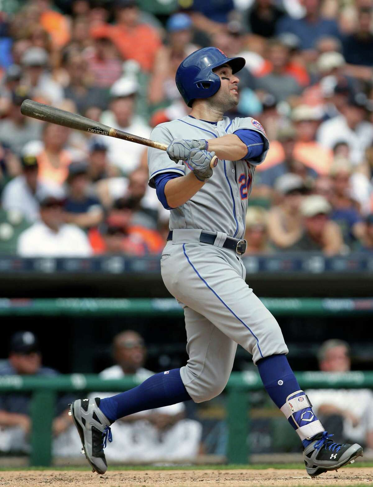 New York Mets' Neil Walker hits a two-run home run against the Detroit Tigers during the ninth inning of an interleague baseball game Sunday, Aug. 7, 2016, in Detroit. (AP Photo/Duane Burleson) ORG XMIT: MIDB107
