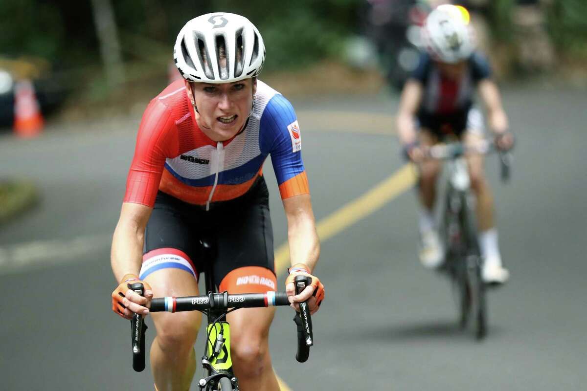 Annemiek van Vleuten, of the Netherlands, leads Mara Abbott, of the United States, during the women's cycling road race at the 2016 Summer Olympics in Rio de Janeiro, Brazil, Sunday, Aug. 7, 2016. (Bryn Lennon/Pool Photo via AP) ORG XMIT: OLY110