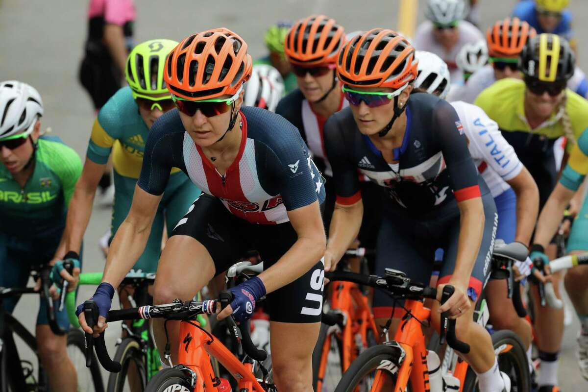 Megan Guarnier of the United States, left, rides in the peloton during the women's cycling road race final at the 2016 Summer Olympics in Rio de Janeiro, Brazil, Sunday, Aug. 7, 2016.(AP Photo/Patrick Semansky) ORG XMIT: OCYC122